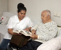 Amado AZ LPN geriatric nurse with patient